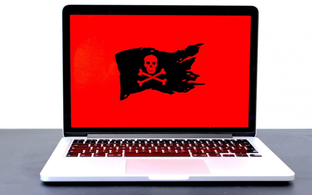 Laptop displaying a pirate flag